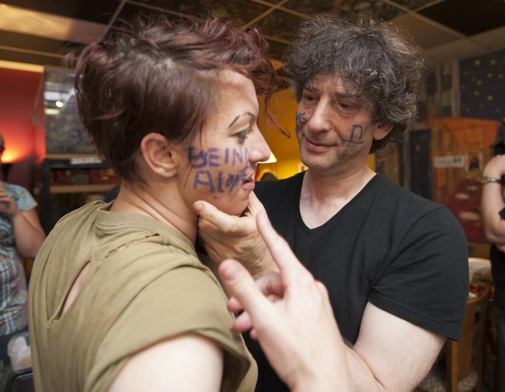 Neil writes Amanda's fear on her cheek. (Photo by Marc Lebryk)