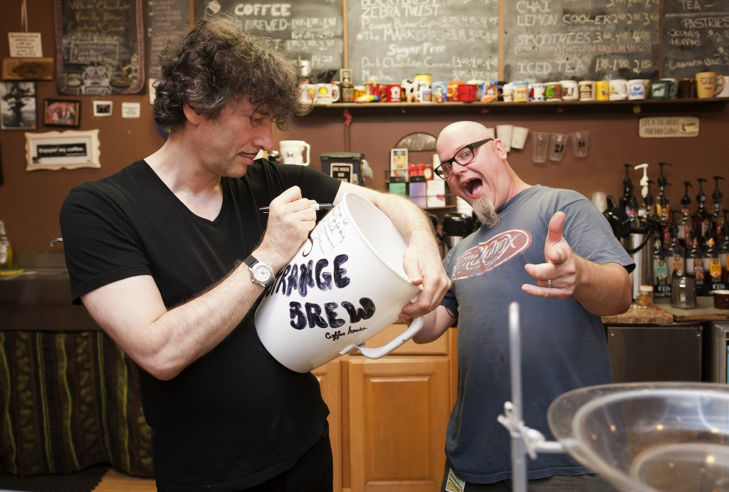 Neil autographs the giant Strange Brew mug, while a charismatic Dill looks on.