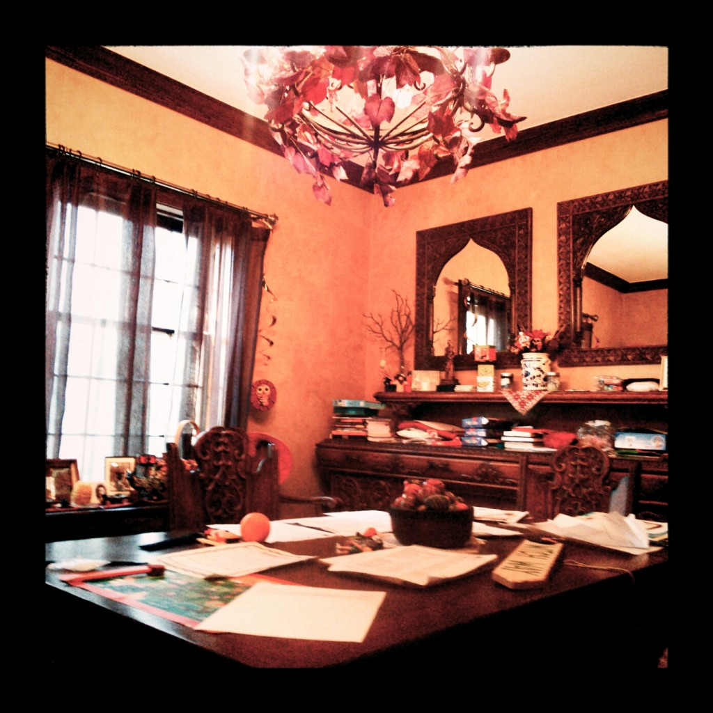 This is my dining room right at this moment--a mess of homework, Halloween, and the ever-moving piles of paperwork.